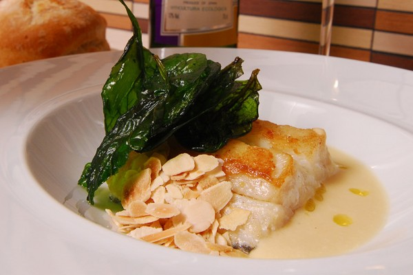 Cod with leek purée, spinach and almonds