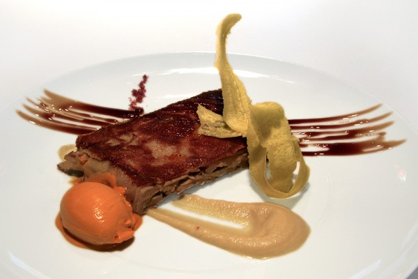 Suckling pig confited in low temperature with a Martíni reduction and red pepper´s ice cream